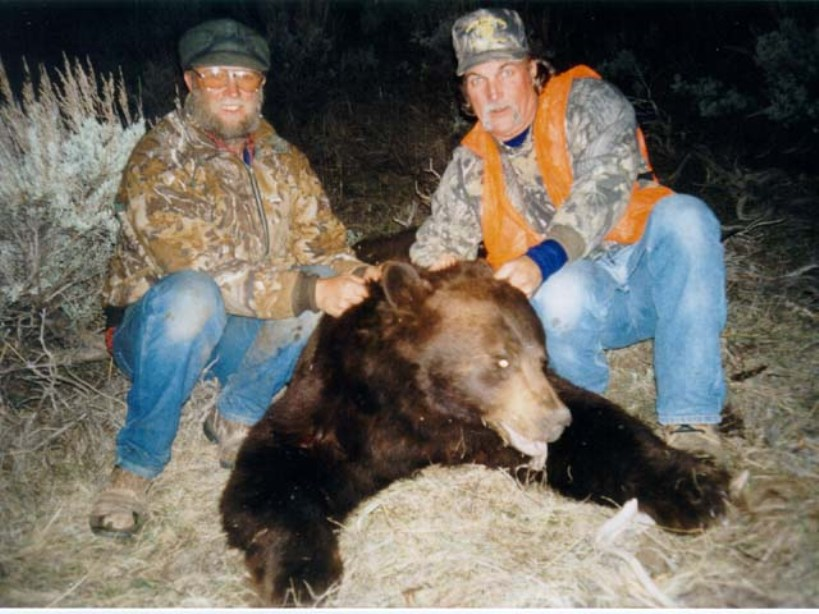 Men Hunting a Black Bear