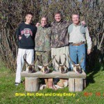 Four Men Standing With Their Antelope Hunts in Montana